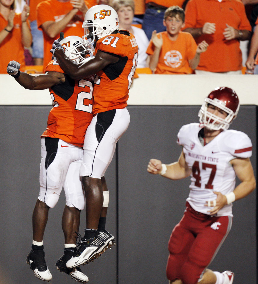 Photo - OSU's Kendall Hunter, left, and Justin Blackmon celebrate near Casey Locker of WSU after Hunter rushed for a touchdown in the third quarter during the college football game between the Washington State Cougars (WSU) and the Oklahoma State Cowboys (OSU) at Boone Pickens Stadium in Stillwater, Okla., Saturday, September 4, 2010. OSU won, 65-17. Photo by Nate Billings, The Oklahoman