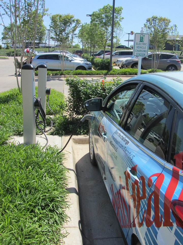 Photo - Men's Health magazine uses the electric vehicle charging station at Whole Foods Market in Oklahoma City during a cross country roadtrip in April.   - PROVIDED BY WHOLE FOODS MARKET