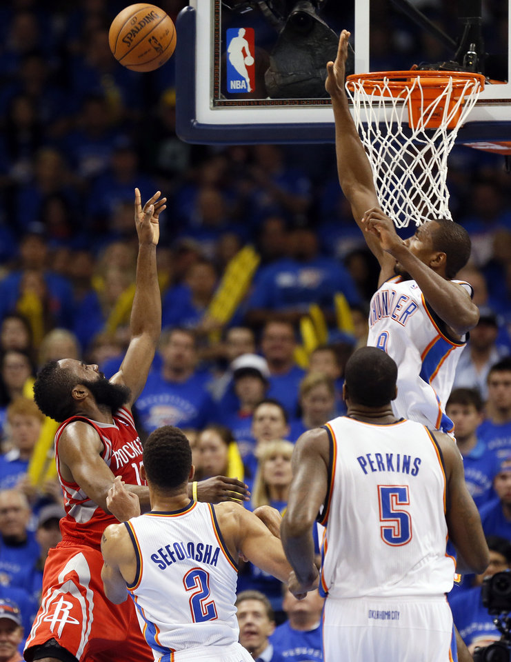 Oklahoma City\'s Serge Ibaka (9) defends a shot by Houston\'s James Harden (13) in front of Oklahoma City\'s Thabo Sefolosha (2) and Kendrick Perkins (5) during Game 2 in the first round of the NBA playoffs between the Oklahoma City Thunder and the Houston Rockets at Chesapeake Energy Arena in Oklahoma City, Wednesday, April 24, 2013. Oklahoma City won, 105-102. Photo by Nate Billings, The Oklahoman