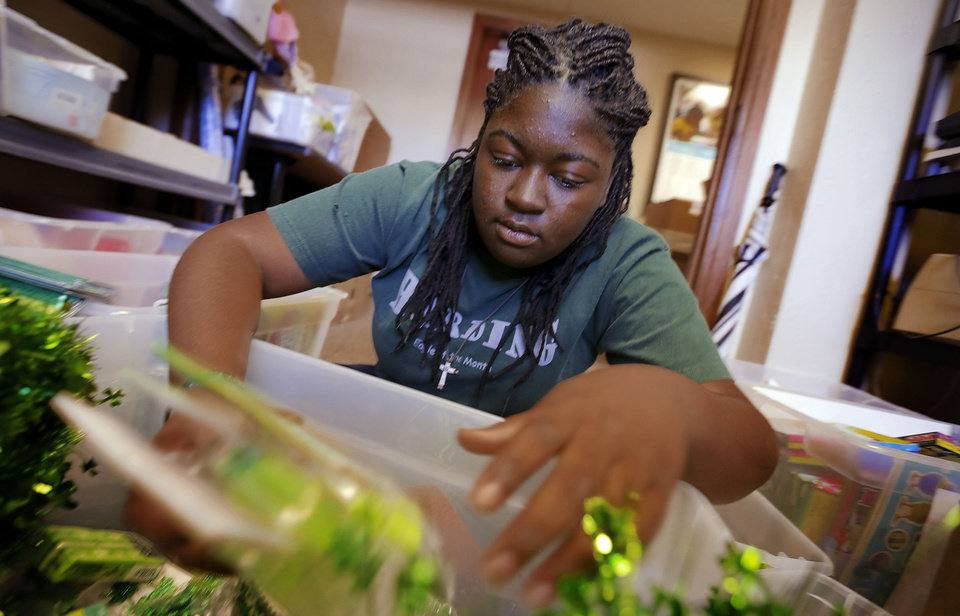 Volunteer Marsheona Welch sorts through classroom supplies Wednesday as the Foundation for Oklahoma City Public Schools starts distributing items for teachers through its Teachers Warehouse. PHOTO BY CHRIS LANDSBERGER, THE OKLAHOMAN <strong>CHRIS LANDSBERGER - CHRIS LANDSBERGER</strong>