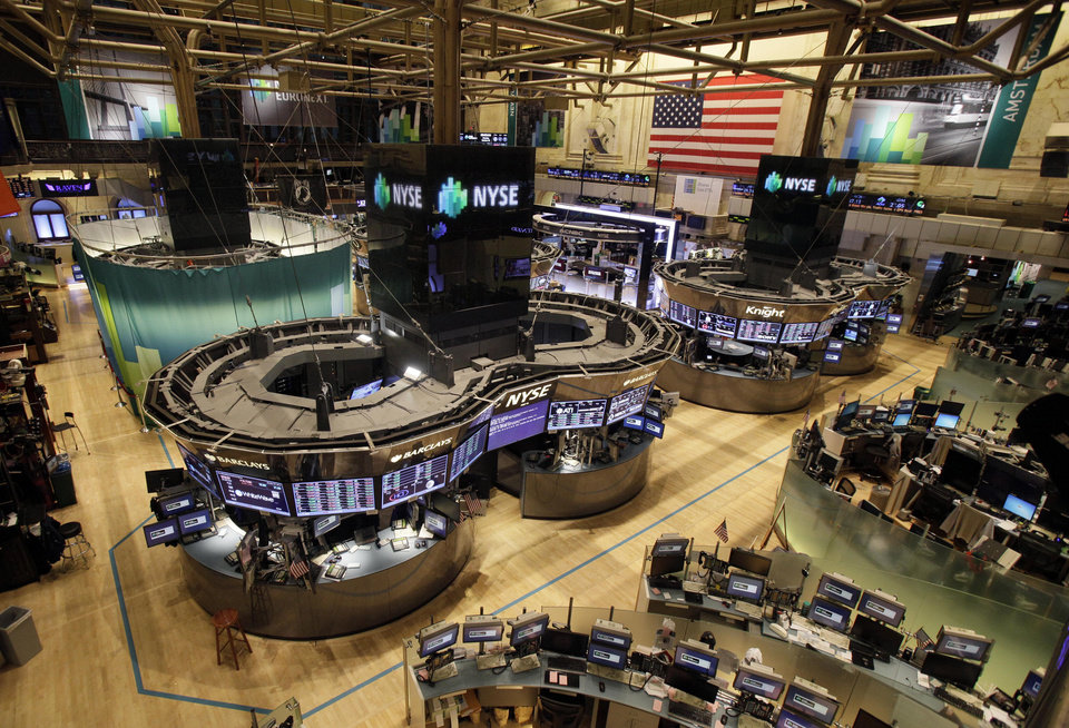 The floor of the New York Stock Exchange is empty of traders, Monday, Oct. 29, 2012, in New York. All major U.S. stock and options exchanges will remain closed Monday with Hurricane Sandy nearing landfall on the East Coast. Trading has rarely stopped for weather. A blizzard led to a late start and an early close on Jan. 8, 1996, according to the exchange\'s parent company, NYSE Euronext. The NYSE shut down on Sept. 27, 1985 for Hurricane Gloria. (AP Photo/Richard Drew) ORG XMIT: NYRD107