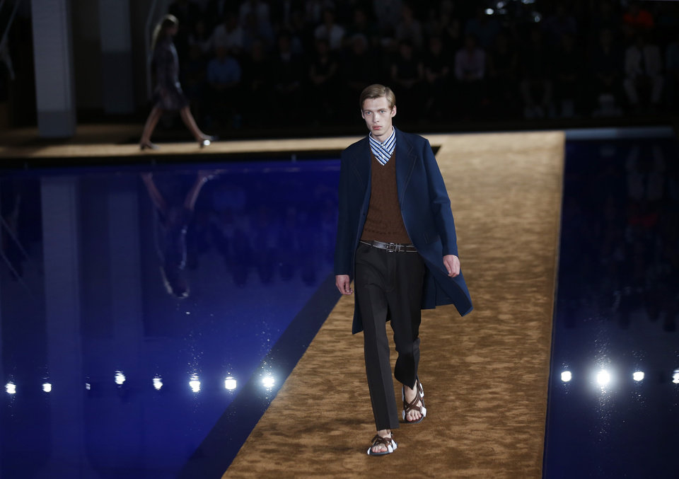 Photo - A model wears a creation for Prada men's Spring-Summer 2015 collection, part of the Milan Fashion Week, unveiled in Milan, Italy, Sunday, June 22, 2014. (AP Photo/Luca Bruno)