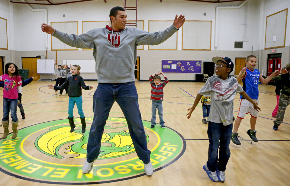 Oklahoma baseball player Adam Choplick talks with nine-year old D.J. Hines as they do jumping jacks during during a wellness fair at Jefferson Elementary School in Norman, Okla., Thursday, Jan. 24. 2013. Photo by Bryan Terry, The Oklahoman