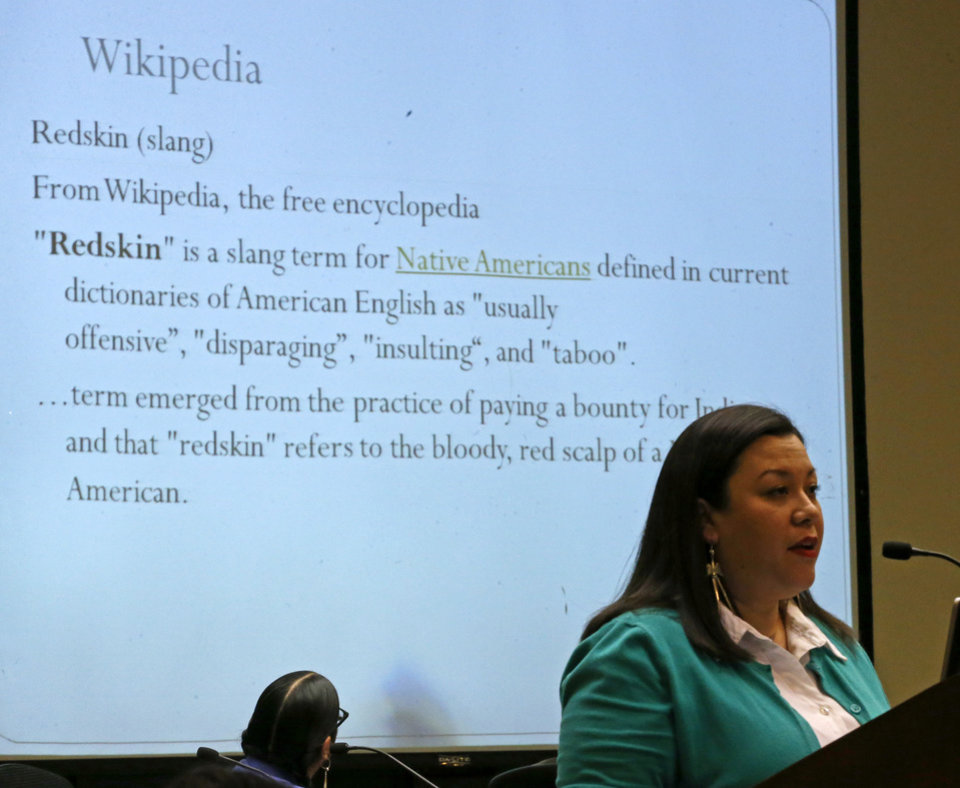 "Photo -  Sarah Adams-Cornell, the forum's moderator, shows the Wikipedia definition of the term ""redskins"" as she leads an educational forum Tuesday.    BRYAN TERRY -  THE OKLAHOMAN"