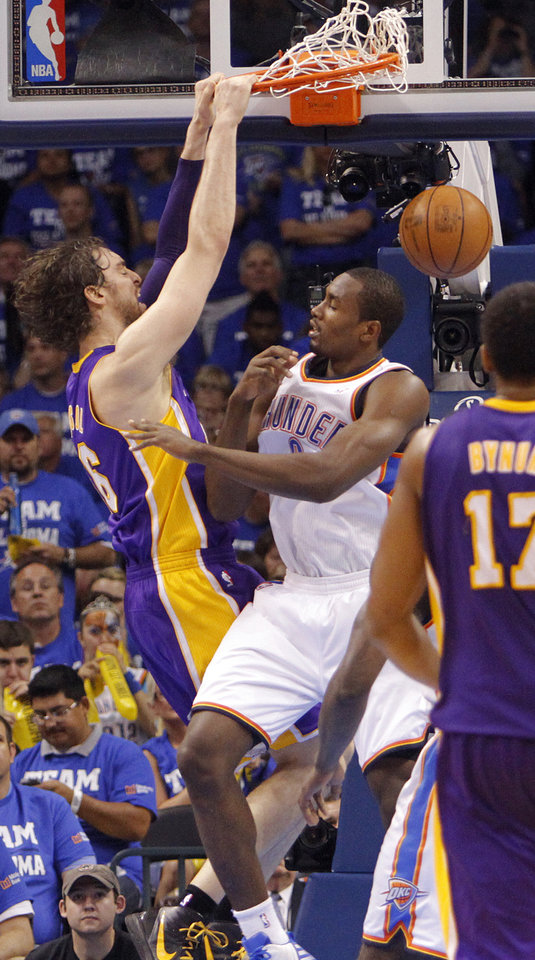 Photo - Los Angeles' Pau Gasol dunks over Oklahoma City's Serge Ibaka during Game 2 in the second round of the NBA playoffs between the Oklahoma City Thunder and the L.A. Lakers at Chesapeake Energy Arena on Wednesday,  May 16, 2012, in Oklahoma City, Oklahoma. Photo by Chris Landsberger, The Oklahoman