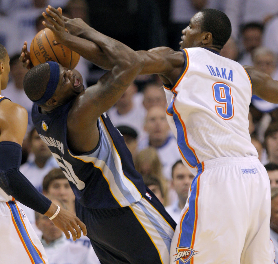 Oklahoma City\'s Serge Ibaka (9) defends Zach Randolph (50) of Memphis during game five of the Western Conference semifinals between the Memphis Grizzlies and the Oklahoma City Thunder in the NBA basketball playoffs at Oklahoma City Arena in Oklahoma City, Wednesday, May 11, 2011. Photo by Bryan Terry, The Oklahoman
