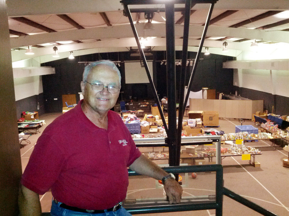 Photo - John Gifford, interim pastor at The Rock Assembly, used his church's gymnasium as a relief center for donations and volunteer housing.  PHOTO BY KYLE SCHWAB - The Oklahoman