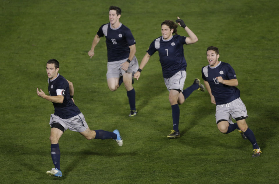 Georgetown players react after a win over Maryland in penalty kicks during a NCAA College Cup men's championship semifinal soccer match at Regions Park, Friday, Dec. 7, 2012, in Hoover, Ala. From left: Georgetown's Tommy Muller, Brandon Allen, Gabe Padilla, and Tyler Rudy. (AP Photo/Dave Martin)