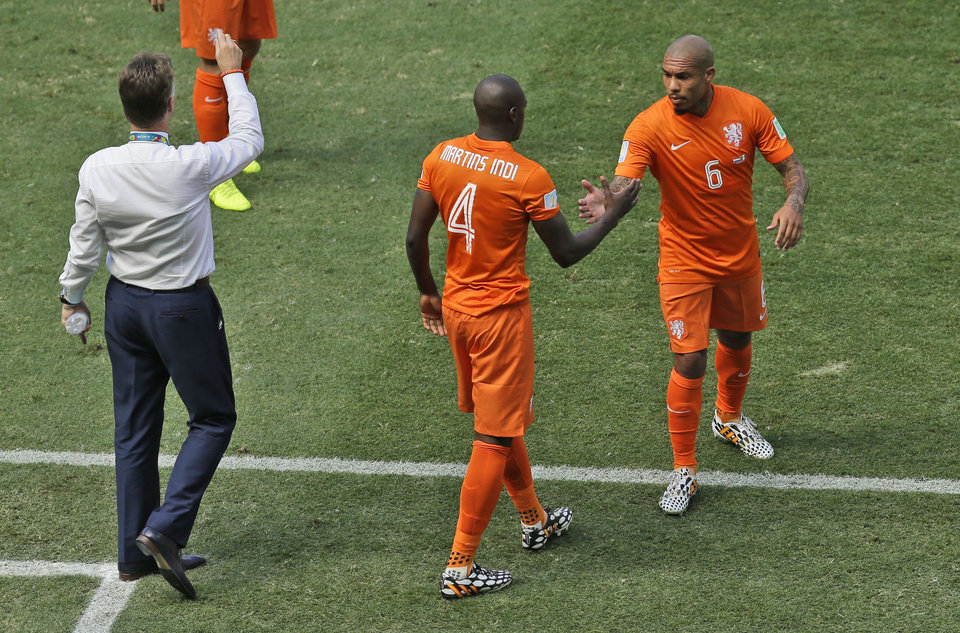 Photo - Netherlands' Nigel de Jong, right, is substituted by his teammate Bruno Martins Indi as head coach Louis van Gaal, left, gives instructions during the World Cup round of 16 soccer match between the Netherlands and Mexico at the Arena Castelao in Fortaleza, Brazil, Sunday, June 29, 2014. (AP Photo/Themba Hadebe)
