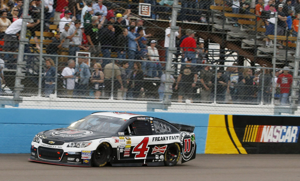 Photo - Kevin Harvick comes in to the finish line to win the NASCAR Sprint Cup Series auto race Sunday, March 2, 2014, in Avondale, Ariz. (AP Photo/Ross D. Franklin)