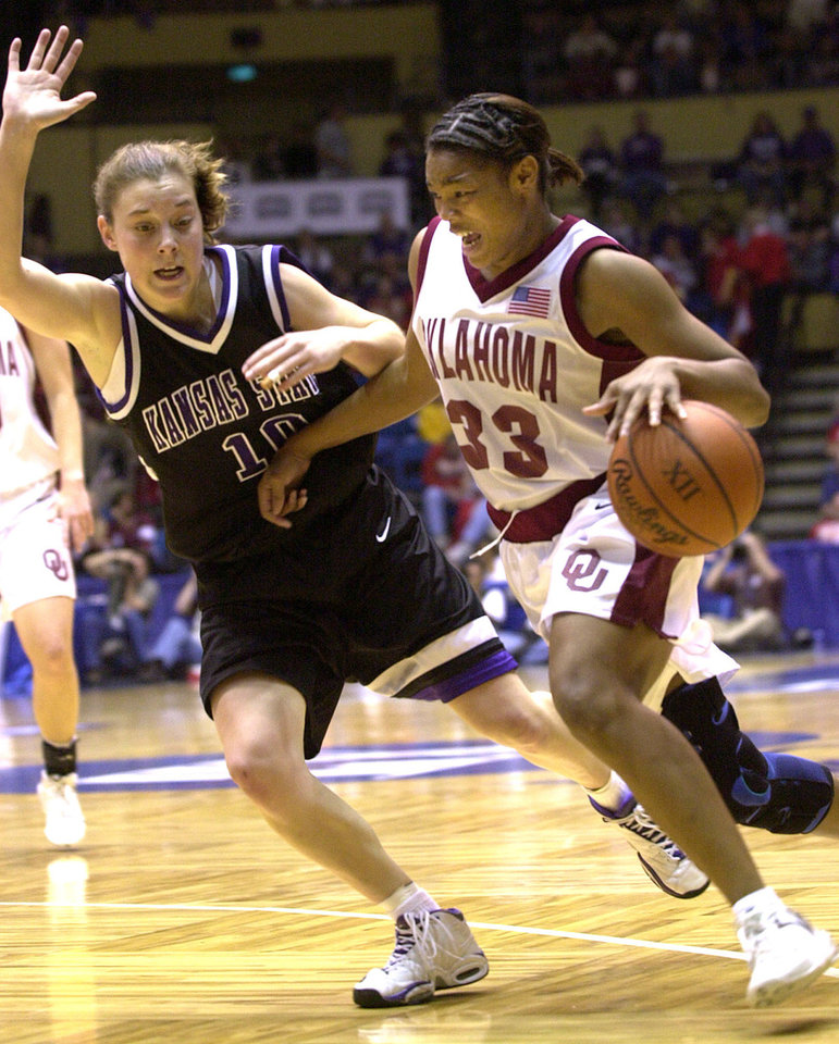 University of Oklahoma women's college basketball against Kansas State University during the semi final round of Women's Big 12 tournament in Municipal Auditorium, Kansas City, Missouri, Thursday, March 7, 2002. Rosalind Ross of OU drives past Laurie Koehn of Kansas State. Staff photo by Bryan Terry