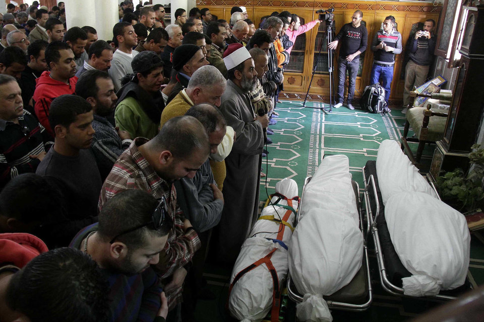 Photo - Egyptians say funeral prayers in a mosque for three people who died in demonstrations marking the second anniversary of the January, 25, 2011, Egyptian revolution in Suez, Egypt, Saturday, Jan. 26, 2013. The unrest was the latest in a bout of violence that has left a total of at least 38 people dead in two days, including over 10 killed in clashes between police and protesters marking Friday's second anniversary of the uprising that overthrew longtime leader Hosni Mubarak. (AP Photo/Ahmed Abd El-Latef, Shorouk Newspaper)   EGYPT OUT