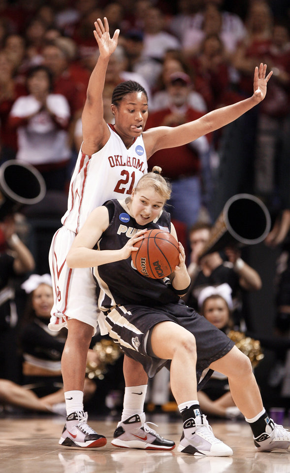 Photo - OU's Amanda Thompson, left, scored five points and played 12 minutes against Purdue.  Photo by steve sisney, the oklahoman