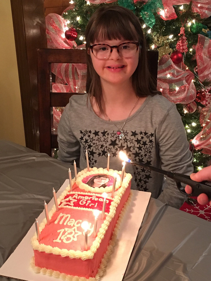 Photo -  Macey celebrates her 13th birthday last year with an American Girl themed cake. [PHOTO PROVIDED]