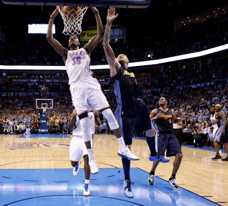 Oklahoma City\'s Kevin Durant (35) ties the game with a dunk as Denver\'s Chris Andersen (11) defends during the NBA basketball game between the Oklahoma City Thunder and the Denver Nuggets at the Chesapeake Energy Arena, Sunday, Feb. 19, 2012. Photo by Sarah Phipps, The Oklahoman