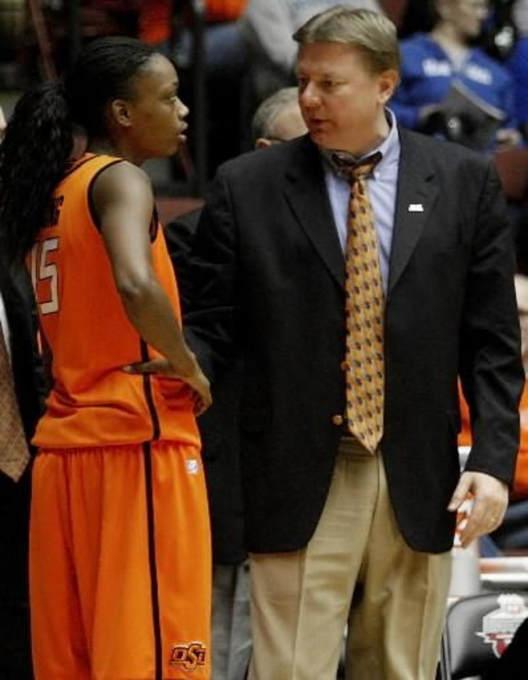 Photo - OSU coach Kurt Budke talks with OSU's Toni Young (15) during the women's college basketball Big 12 Championship tournament game between Oklahoma State and Texas Tech in Kansas City, Mo., Tuesday, March 8, 2011. Photo by Bryan Terry