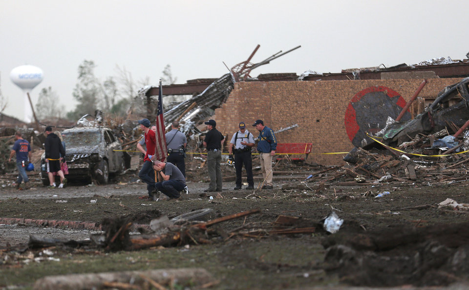 People react in front of the Towers Elementary school in Moore following a deadly tornado, Monday, May 20, 2013. Photo by Sarah Phipps, The Oklahoman