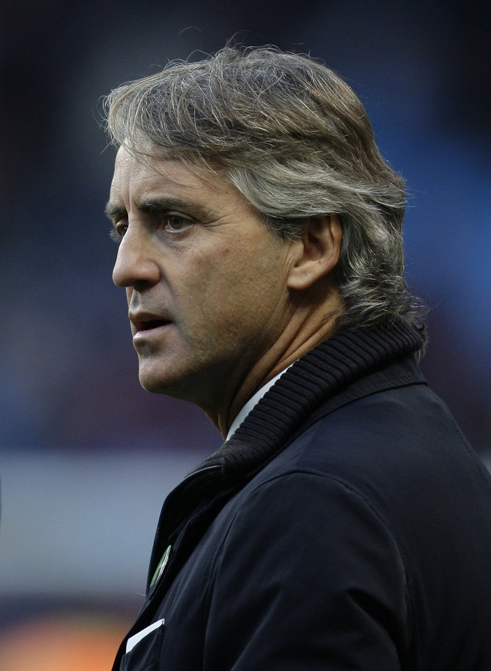 Photo -   Manchester City's manager Roberto Mancini takes to the touchline before their English Premier League soccer match against Swansea City at The Etihad Stadium, Manchester, England, Saturday, Oct. 27, 2012. (AP Photo/Jon Super)