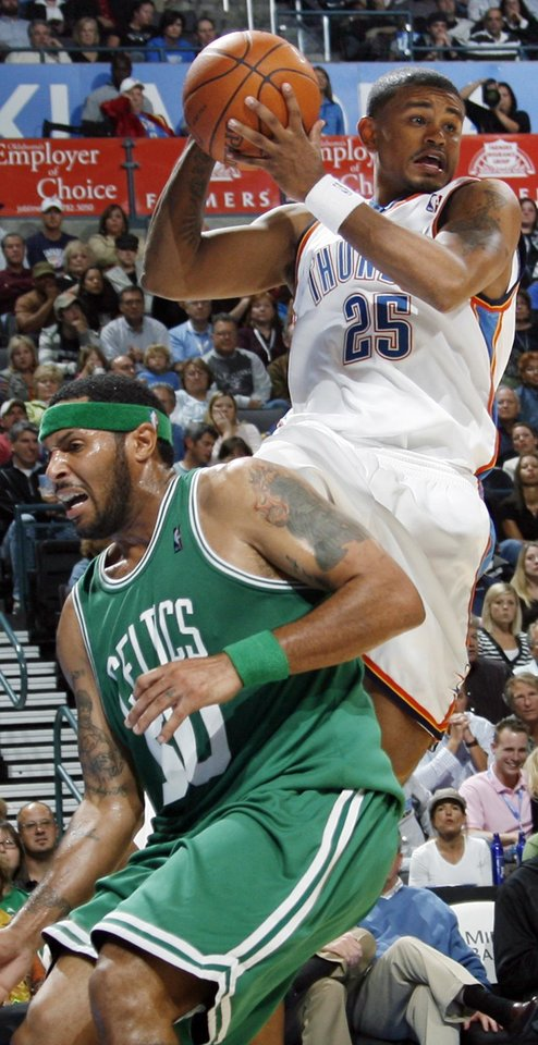 Photo - Earl Watson of the Thunder passes the ball over Boston's Eddie House in the first half during the NBA basketball game between the Oklahoma City Thunder and the Boston Celtics at the Ford Center in Oklahoma City, Wednesday, Nov. 5, 2008. BY NATE BILLINGS, THE OKLAHOMAN