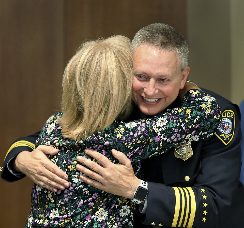"Photo -  New Oklahoma City Police Chief Wade Gourley  is hugged by a well-wisher after appearing at a news conference at police headquarters Monday, July 8, 2019, to be introduced by City Manager Craig Freeman as the new chief. Gourley has been an Oklahoma City police officer for 30 years and was serving as one of the police department's four deputy chiefs before being promoted to chief. He succeeds former Police Chief Bill Citty, who retired in May after 15 years as head of the department.  Freeman said ""Chief Gourley fits the mold of what we're looking for: he's open, honest, innovative and experienced, and he will lead by example. I'm confident he will lead our police department to continue to serve and protect all residents in a fair and equitable manner.""  Gourley is Oklahoma City's 50th chief. He will oversee the 1,235 uniformed officers and 304 other staff members in the police department.  [Jim Beckel/The Oklahoman]"