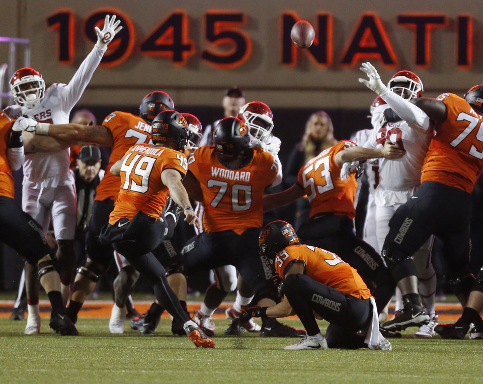 Photo - Oklahoma State's Matt Ammendola (49) kicks a field goal at the end of the first half during the Bedlam college football game between the Oklahoma State Cowboys (OSU) and Oklahoma Sooners (OU) at Boone Pickens Stadium in Stillwater, Okla., Saturday, Nov. 30, 2019. [Nate Billings/The Oklahoman]