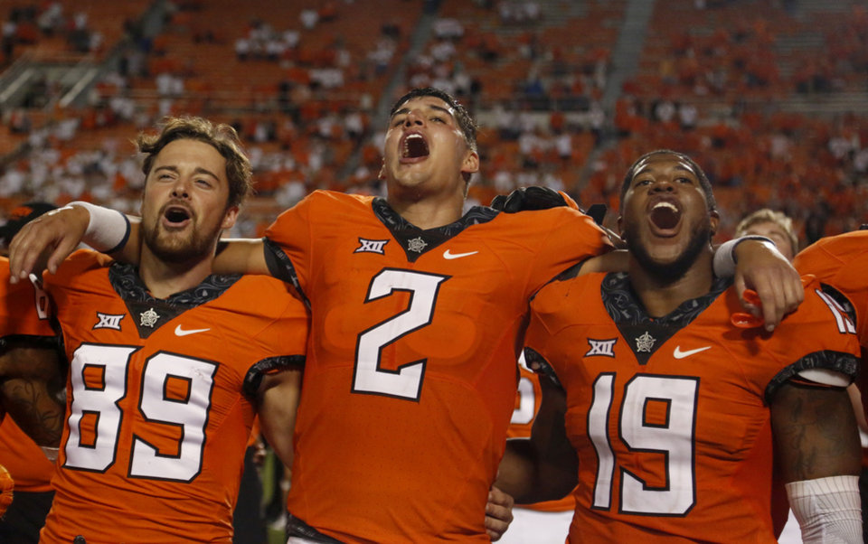 Photo - Oklahoma State's Mason Rudolph (2) sings the alma mater during a college football game between the Oklahoma State Cowboys (OSU) and the Pitt Panthers at Boone Pickens Stadium in Stillwater, Okla., Saturday, Sept. 17, 2016. Photo by Sarah Phipps, The Oklahoman