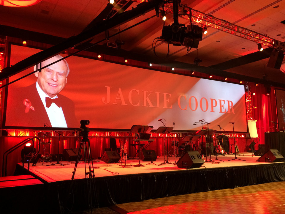 Photo -  The 23rd Annual Red Tie Night benefiting the Oklahoma AIDS Care Fund was March 7 at the Cox Convention Center. Jackie Cooper, who founded Red Tie Night with his wife Barbara in 1991, passed away Feb. 27, one week before the event and was honored posthumously during the gala. Photo provided