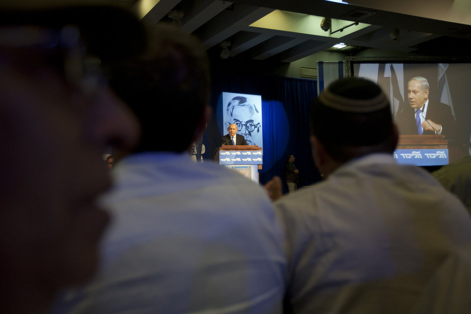 Photo -   Israel's Prime Minister Benjamin Netanyahu delivers a speech to his Likud party members during the party convention in Tel Aviv, Israel, Sunday, May 6, 2012. Prime Minister Benjamin Netanyahu is expected to announce Sunday night that he'll dissolve parliament to hold early elections, a move designed to fend off domestic critics and perhaps put him in a stronger position to act against Iran.(AP Photo/Ariel Schalit)