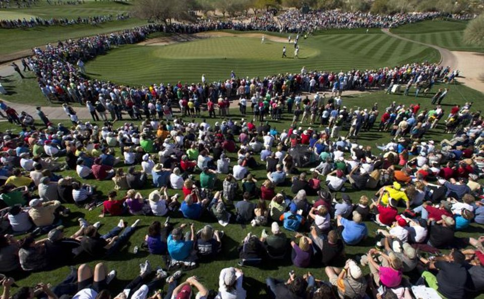 Phil Mickelson walks into the second green, which was surrounded by a large gallery, during the second round of the Phoenix Open golf tournament Friday, Feb. 1, 2013, in Scottsdale, Ariz. (AP Photo/The Arizona Republic, Rob Schumacher) MESA OUT  MARICOPA COUNTY OUT  MAGS OUT  NO SALES