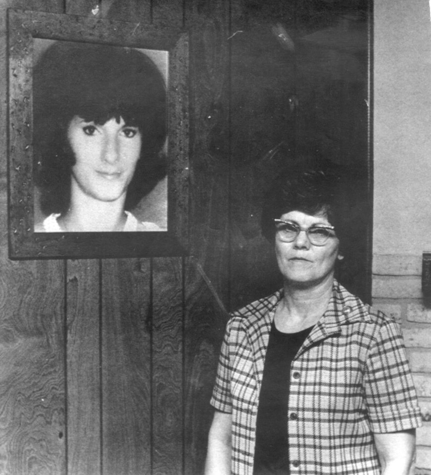 Photo - Merle Silkwood stands next to a photo of her daughter, Karen Silkwood in this 1979 photo taken in Nederland, TX, where Merle lives. Karen Silkwood was a Kerr McGee employee that worked at the plutonium plant near Cresent and the Cimmaron River.