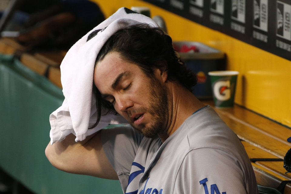 Photo - Los Angeles Dodgers starting pitcher Dan Haren wipes his head in the dugout before a baseball game against the Pittsburgh Pirates in Pittsburgh, Wednesday, July 23, 2014. (AP Photo)