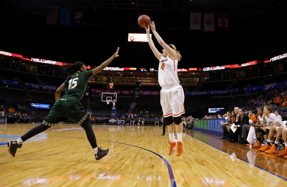 Oklahoma State's Liz Donohoe (4) shoots a three-point basket over South Florida's Shavontae Naylor (15)  during the All-College Classic women's basketball game between Oklahoma State University and South Florida at Chesapeake Energy Arena in Oklahoma City, Okla., Saturday, Dec. 14, 2013. Photo by Bryan Terry, The Oklahoman
