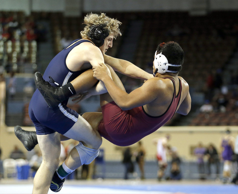 Photo - Edmond North's Joel Dixon wrestles Owasso's 	Teejay Aiono in the 6A 195-pound match during the state wrestling tournament at the State Fair Arena in Oklahoma City,  Friday, Feb. 22, 2013. Photo by Sarah Phipps, The Oklahoman