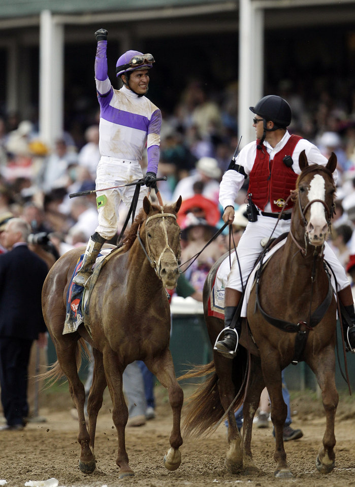 Jockey Mario Gutierrez celebrates after riding I'll Have Another to victory in the 138th Kentucky Derby horse race at Churchill Downs Saturday, May 5, 2012, in Louisville, Ky. (AP Photo/Matt Slocum)  ORG XMIT: DBY195