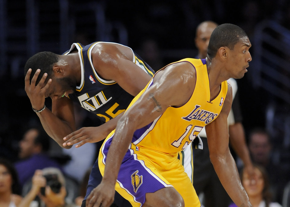 Photo -   Utah Jazz center Al Jefferson (25) reacts after colliding with Los Angeles Lakers forward Metta World Peace (15) in the first half of an NBA preseason basketball game, Saturday, Oct. 13, 2012, in Los Angeles. (AP Photo/Gus Ruelas)