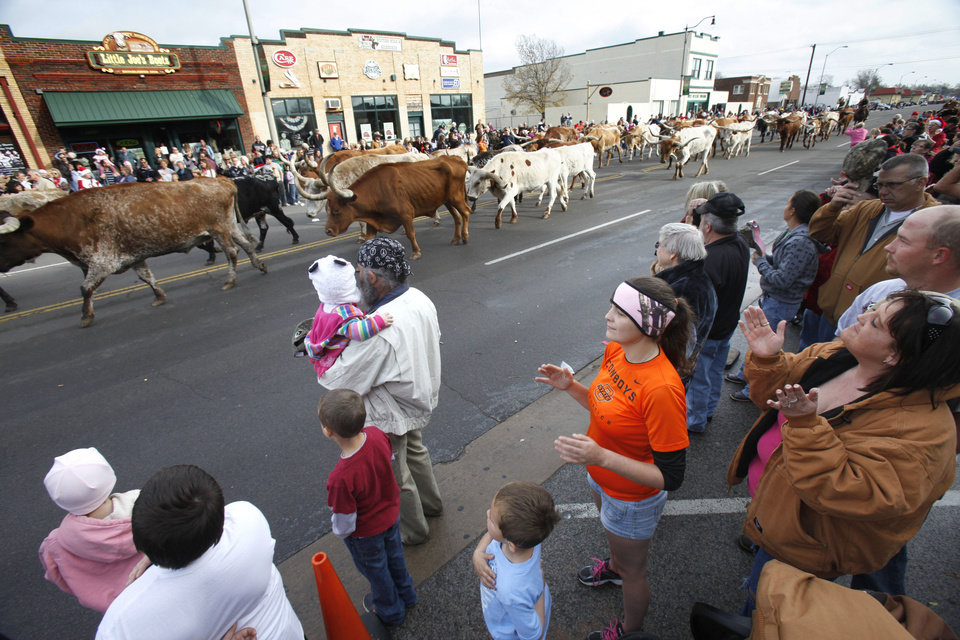 Longhorn cattle are driven down Exchange Ave. during the Stockyards City Christmas parade in Oklahoma City, OK, Saturday, December 1, 2012,  By Paul Hellstern, The Oklahoman