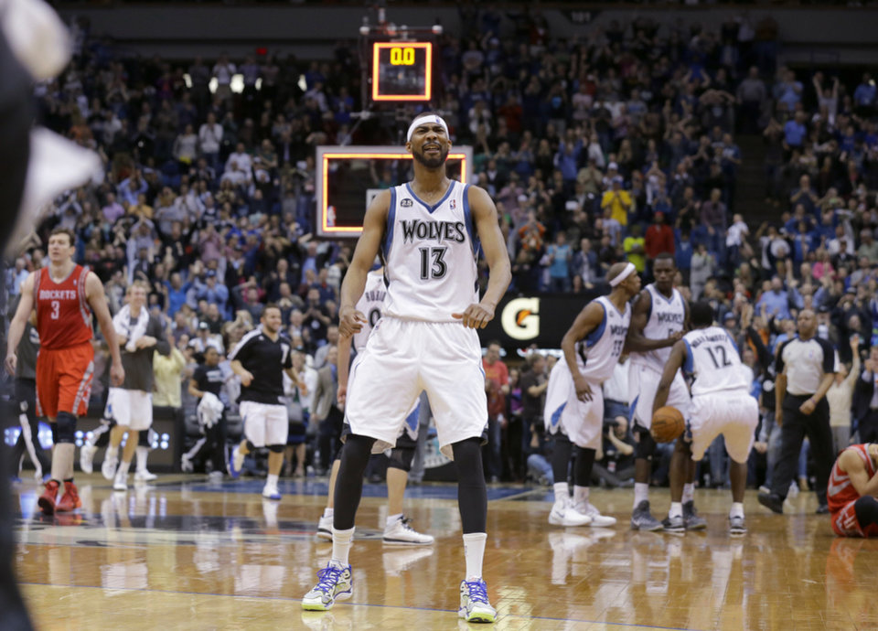 Photo - Minnesota Timberwolves forward Corey Brewer reacts after the Timberwolves defeated the Houston Rockets 112-110 during an NBA basketball game in Minneapolis, Friday, April 11, 2014. (AP Photo/Ann Heisenfelt)