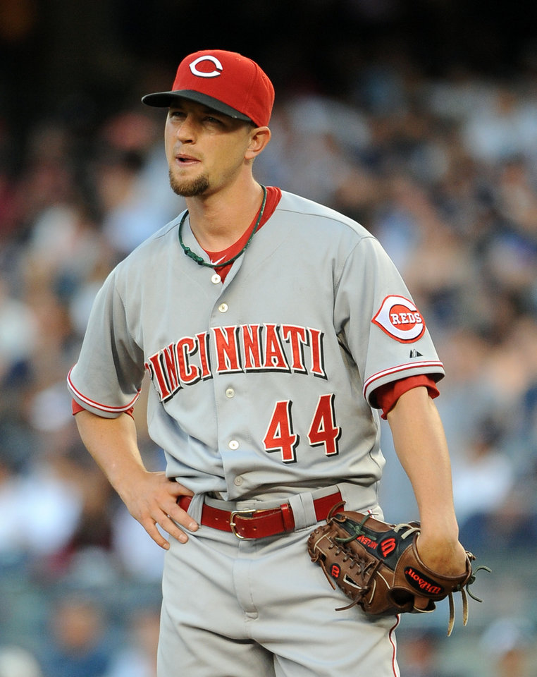Photo - Cincinnati Reds starting pitcher Mike Leake reacts after walking New York Yankees' Mark Teixeira in the first inning of an interleague baseball game at Yankee Stadium on Friday, July 18, 2014, in New York. (AP Photo/Kathy Kmonicek)