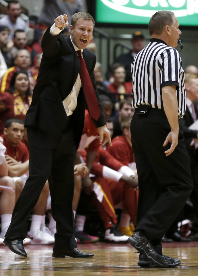 Photo - Iowa State coach Fred Hoiberg argues for a foul call against West Virginia during the first half of an NCAA college basketball game in Ames, Iowa, Wednesday, Feb. 26, 2014. (AP Photo/Justin Hayworth)