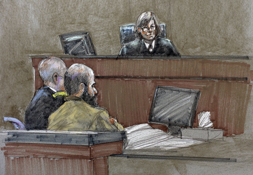 Photo - In this courtroom sketch, Maj. Nidal Hasan, center, sits before the judge, U.S. Army Col. Tara Osborn, at the Lawrence William Judicial Center during the sentencing phase of his trial, Wednesday, Aug. 28, 2013, in Fort Hood, Texas. The jury found Hasan unanimously guilty on the 13 charges of premeditated murder in the 2009 shooting at Fort Hood, and he is eligible for the death penalty. (AP Photo/Brigitte Woosley)