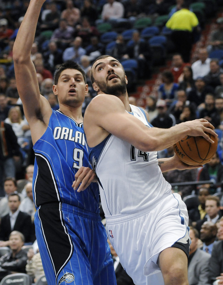 Minnesota Timberwolves' Nikola Pekovic, right, of Montenegro, eyes the basket as Orlando Magic's Nikola Vucevic, also of Montenegro, defends in the first half of an NBA basketball game Wednesday, Nov. 7, 2012, in Minneapolis. (AP Photo/Jim Mone)