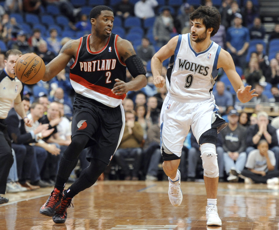 Portland Trail Blazers' Wesley Matthews (2) moves the ball alongside Minnesota Timberwolves' Ricky Rubio (9), of Spain, during the fourth quarter of an NBA basketball game Monday, Feb. 4, 2013, in Minneapolis. The Trail Blazers won 100-98. (AP Photo/Hannah Foslien)