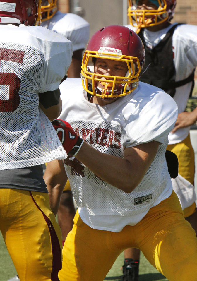 Photo - Logan Price participates in morning practice at Putnam City North High School in Oklahoma City, OK, Monday, August 18, 2014,  Photo by Paul Hellstern, The Oklahoman