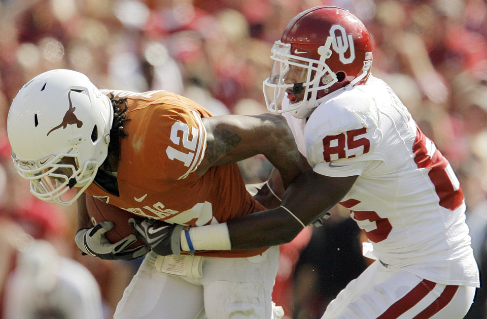 Photo - OU's Ryan Broyles (85) tackles Earl Thomas (12) of Texas after Thomas intercepted a pass by Landry Jones (not pictured) late in the fourth quarter during the Red River Rivalry college football game between the University of Oklahoma Sooners (OU) and the University of Texas Longhorns (UT) at the Cotton Bowl in Dallas, Texas, Saturday, Oct. 17, 2009. Texas won, 16-13. Photo by Nate Billings, The Oklahoman