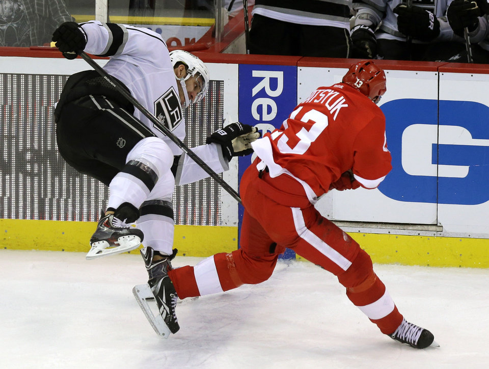 Photo - Detroit Red Wings center Pavel Datsyuk (13), of Russia, checks Los Angeles Kings center Dwight King during the third period of an NHL hockey game in Detroit, Wednesday, April 24, 2013. (AP Photo/Carlos Osorio)