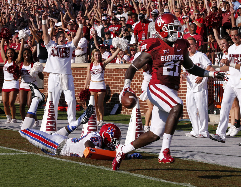 Photo - Oklahoma Sooners's Keith Ford (21) scores the first touchdown of the game during a college football game between the University of Oklahoma Sooners (OU) and the Louisiana Tech Bulldogs at Gaylord Family-Oklahoma Memorial Stadium in Norman, Okla., on Saturday, Aug. 30, 2014. Photo by Steve Sisney, The Oklahoman