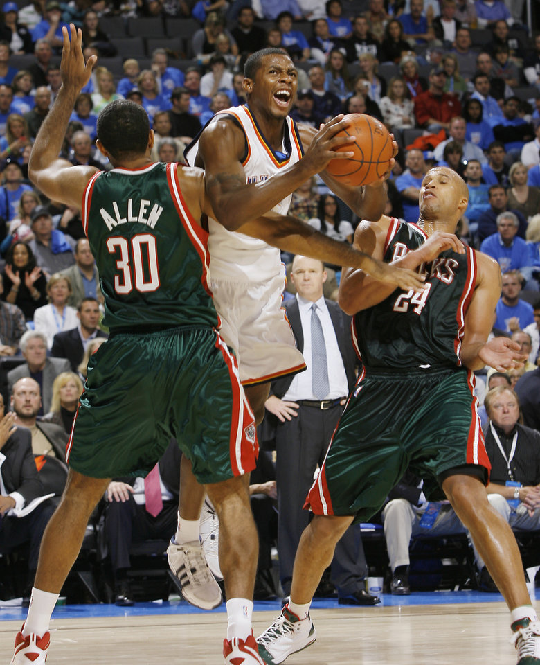 Desmond Mason (34) of the Thunder drives against the Bucks' Malik Allen (30) and Richard Jefferson (24) during the opening NBA basketball game between the Oklahoma City Thunder and the Milwaukee Bucks at the Ford Center in Oklahoma City, Wednesday, October 29, 2008.  BY BRYAN TERRY, THE OKLAHOMAN