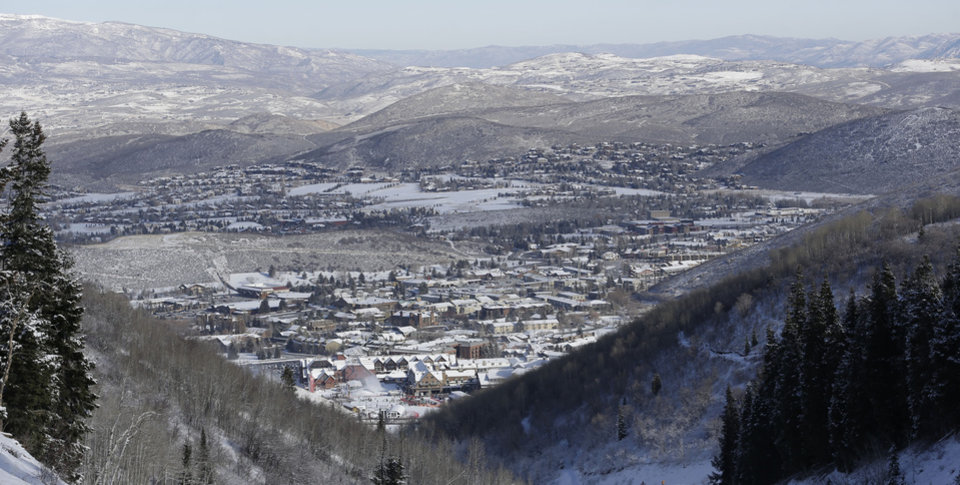 Photo - FILE - This Nov. 23, 2013, file photo, shows Park City from a trail at the Park City Mountain Resort, in Park City, Utah. A long-running court battle between two ski industry titans is putting the upcoming season in jeopardy at one of Utah's largest resorts. A Utah judge is expected to decide Friday how much Park City Mountain Resort must pay to cover back rent and court costs so it can stay open through April 2015. If the price tag is too high, the lifts could stand idle when the season opens in less than three months. (AP Photo/Rick Bowmer, File)