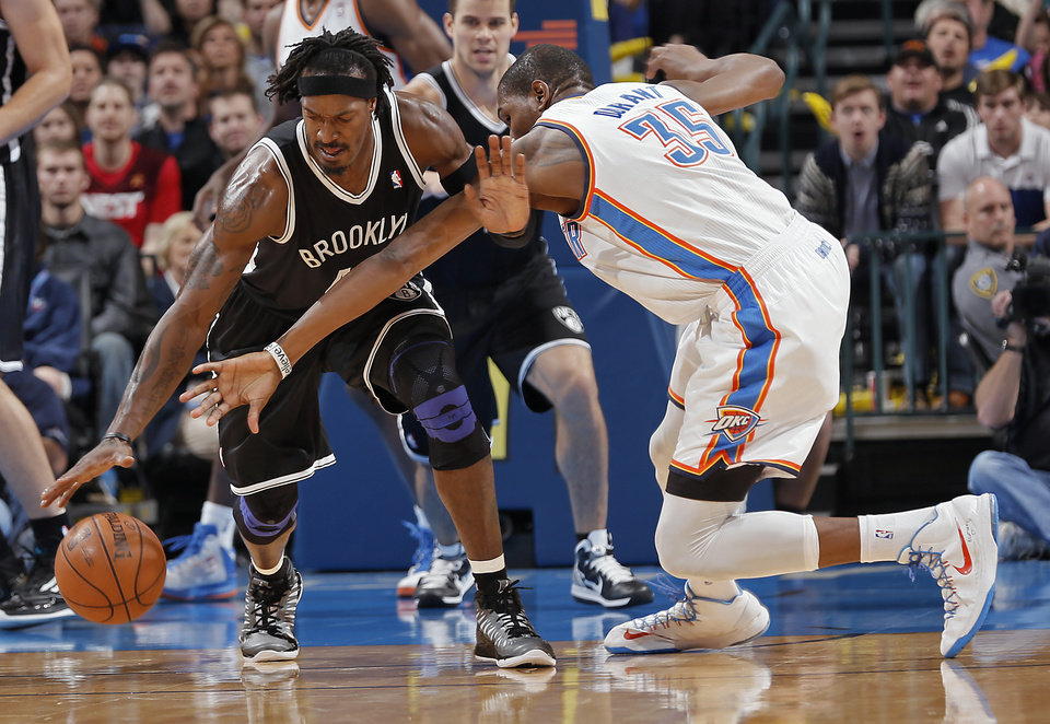 Photo - Brooklyn Nets' Gerald Wallace (45) gets a steal on Oklahoma City's Kevin Durant (35) during the NBA basketball game between the Oklahoma City Thunder and the Brooklyn Nets at the Chesapeake Energy Arena on Wednesday, Jan. 2, 2013, in Oklahoma City, Okla. Photo by Chris Landsberger, The Oklahoman