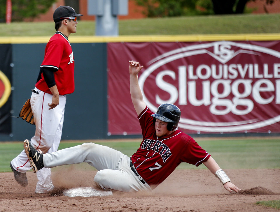 Photo - Putnam City North's Carson James (7) slides in safe to second base during the Class 6A baseball state tournament game between Puntnam City North and Bishop Kelley at the University of Oklahoma in Norman, Okla. on Thursday, May 15, 2014.   Photo by Chris Landsberger, The Oklahoman